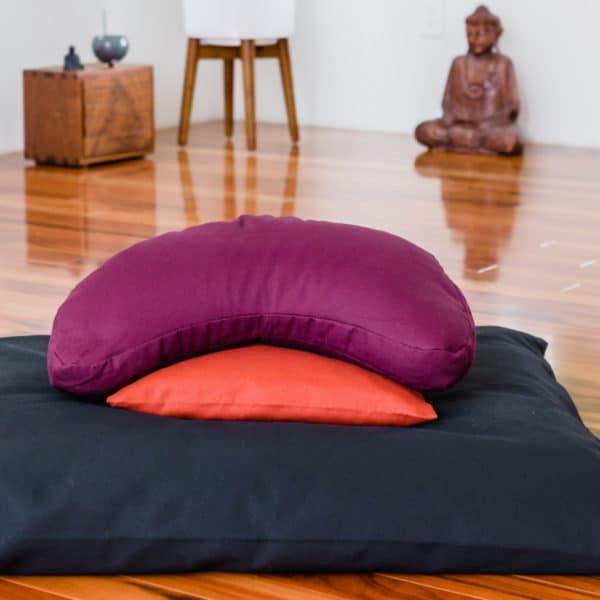 Crescent Zafu and zabuton meditation cushion set in calm meditation space